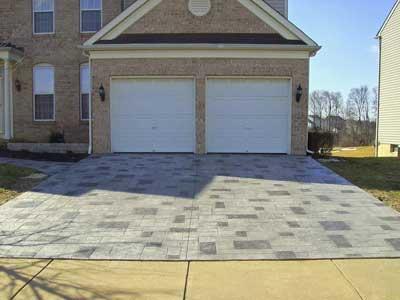 gray brick stamped concrete driveway