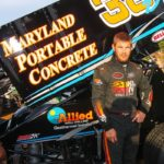Kyle Denmeyer with race car showing MPC logo
