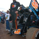 Kyle Denmeyer with his race car