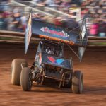 Denmeyer racing on dirt track from front