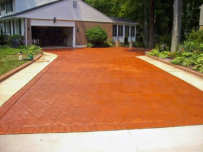 red brick stained concrete driveway