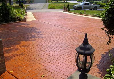 red brick stained imprinted concrete driveway