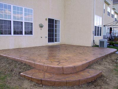 red stamped concrete patio